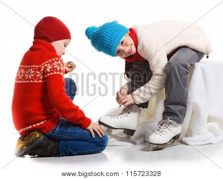 Happy children in the skate rink, isolated on white