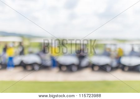 Abstract Blurred Photo Of Golf Cart With Caddy And Beautiful Blue Sky Background.