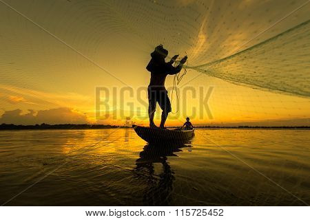 Fishermen silhouette lifestyle in action when fishing in river