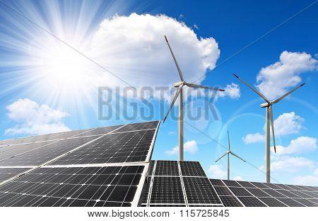 Solar energy panels and wind turbines.