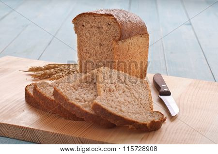 Homemade A Loaf Of Bread With Sliced Pieces Of Bread