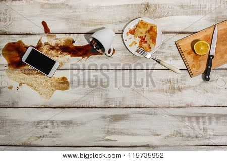 Cup of coffee spilled on wooden table