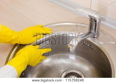 Woman Cleaning Kitchen Sink
