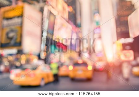 Defocused Yellow Taxi Cabs And Rush Hour On Times Square In Manhattan Downtown New York City