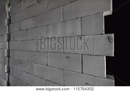 Raw AAC autoclaved aerated concrete wall, angle view, editable background.