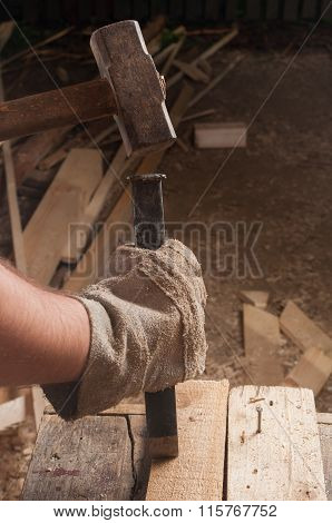 Hammer Hitting A Chisel.