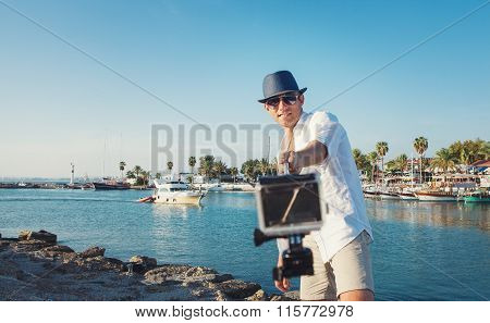 Positive Young Man Take A Selfie Photo In Tropical Harbor
