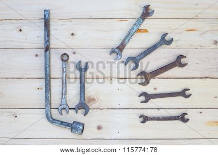 Rusty Wrench On White Wood