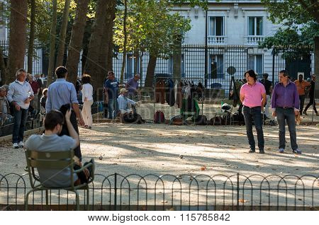 PARIS FRANCE - SEPTEMBER 9 2014: Playing petanque in the late afternoon in Luxemburg Garden in Paris France