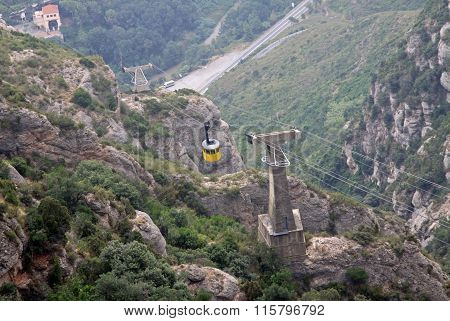 Montserrat, Spain - August 28, 2012: The Cableway Montserrat-aeri To The Benedictine Abbey Santa Mar