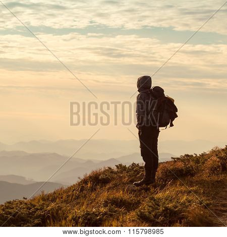 Traveler with backpack and mountain panorama