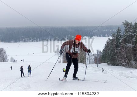 Smiling Cross Country Skiing Girl In A Steep Uphill Slope