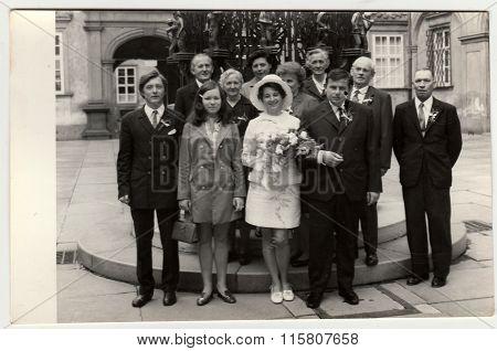 A vintage photo shows wedding photo, circa 1970.