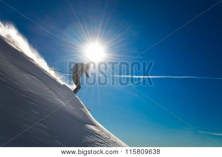 Cross country skiing during the descent in deep snow