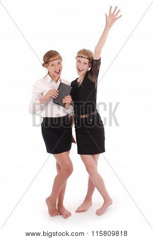 Girls Holding Tablet Pcs Lifting Arm