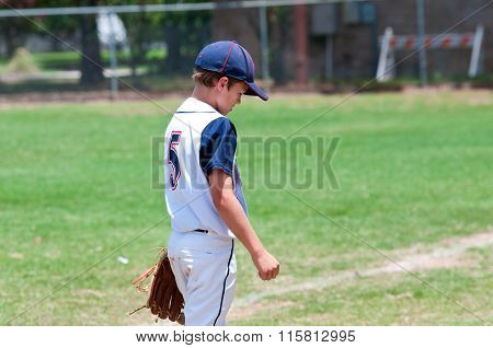 Young American Baseball Boy on field