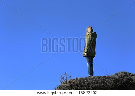 Woman on the top of the mountain