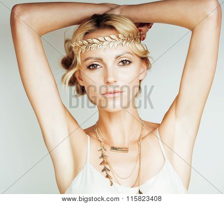 young blond woman dressed like ancient greek godess, gold jewelry close up isolated