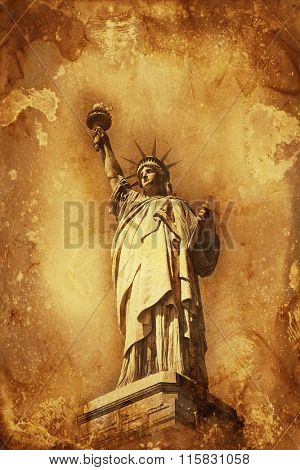 Grunge colorful yellow and brown watercolor paint effect Statue of Liberty holding aloft the torch of Freedom with copy space for a travel or tourism themed concept