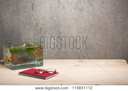 Fish Tank Notebook And Glasses On Table Wooden