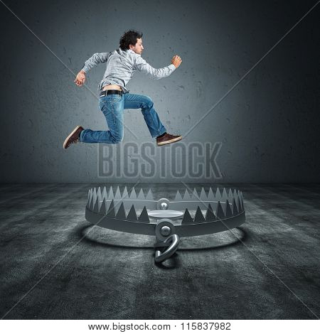 worker jump over bear trap