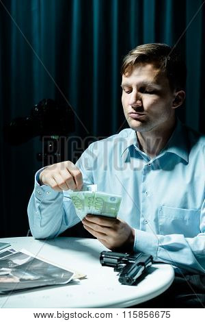 Madman Counting Money For Murder