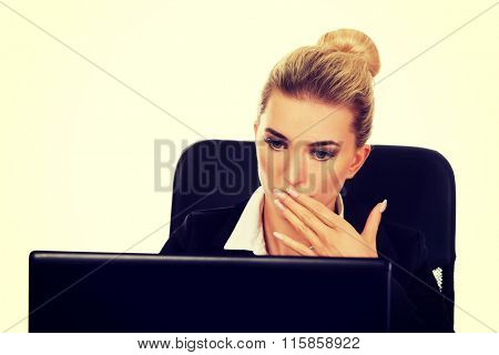 Surprised and curious businesswoman cannot believe what she sees