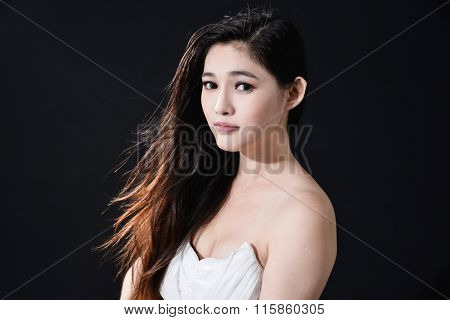 fashion model in sexy clothes posing in studio