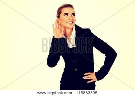Young blonde businesswoman overhears gossip
