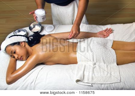 Sea Salt Scrub Massage Treatment In A Spa Setting.