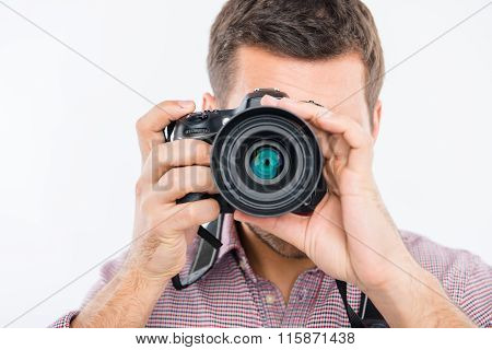 Close Up Portrait Of Young Photographer Taking Photo