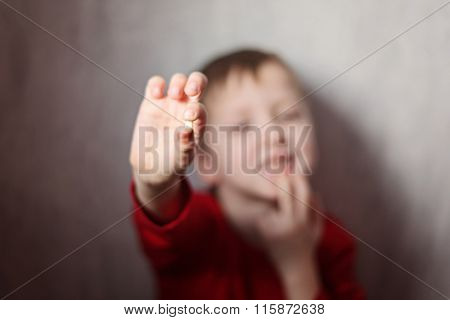 Little Boy Showing His First Lost Milk-tooth In His Hand.