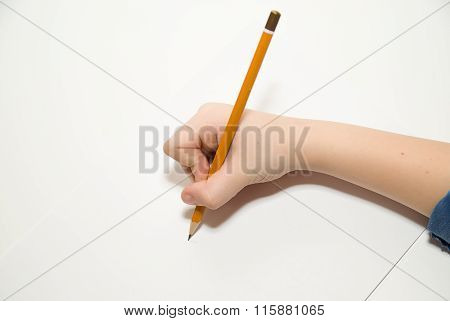Kid's Right Hand Holding A Pencil On Over White