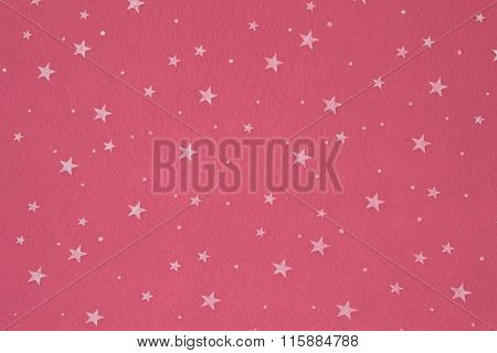Close-up of pink felt with stars background.