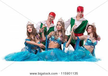 Carnival dancer team dressed as mermaids and pirates.  Isolated on white background in full length.