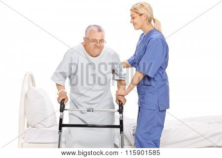 Young female nurse assisting a senior patient with a walker isolated on white background
