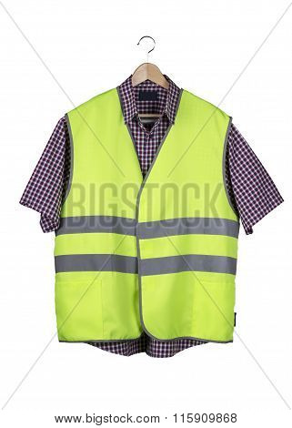 Construction Vest And Shirt On A Wooden Hanger