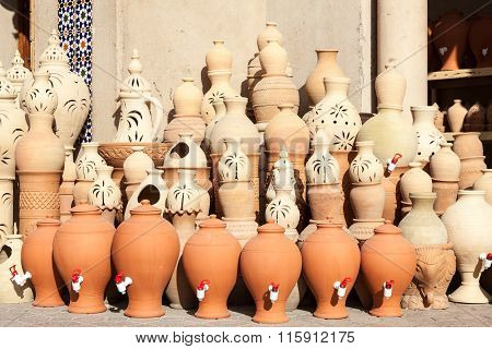 Terracotta pots for sale in Nizwa souk. Sultanate of Oman Middle East poster