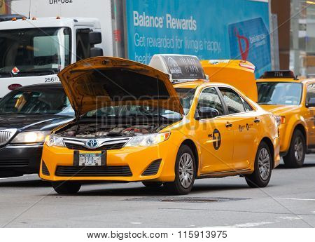 Yellow Cab Stopped In Traffic Due To The Broken Engine