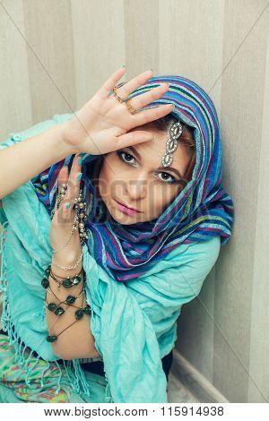 Beautiful Oriental Woman In A Traditional Headscarf.