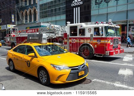 Fdny Firetruck And Yellow Cab In Manhattan
