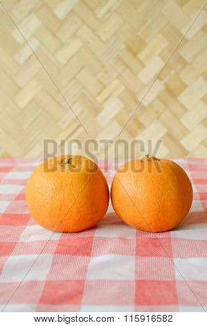 oranges on tablecloth