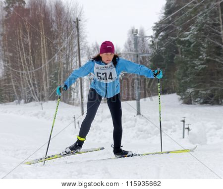 Focused Cross Country Skiing Woman In A Steep Uphill Slope