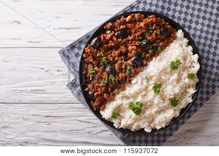 Picadillo A La Habanera With Rice On The Table. Horizontal Top View