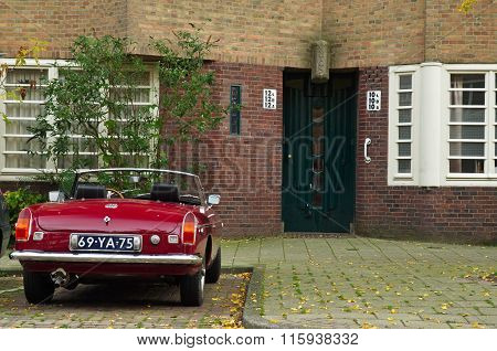 Amsterdam School Entrance With Vintage Mg Car