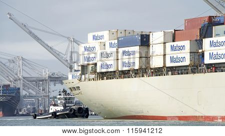 Tugboat Z-five At The Stern Of Matson Cargo Ship Manoa