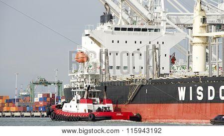 Tugboat Valor Off The Starboard Quarter Of Bulk Carrier Bunun Ace, Assisting The Vessel To Maneuver