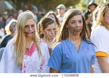 Teenagers Wearing Gruesome Zombie Makeup Walk At Georgia Halloween Festival
