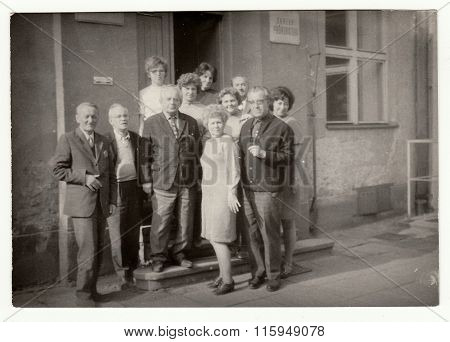 THE CZECHOSLOVAK SOCIALIST REPUBLIC CIRCA 1970s: Vintage photo shows group of people in front of building.