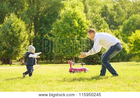 Happy Father And Son On A Walk On A Sunny Day